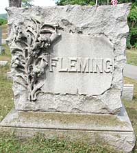 Fancy lilies carved on a Fleming family monument